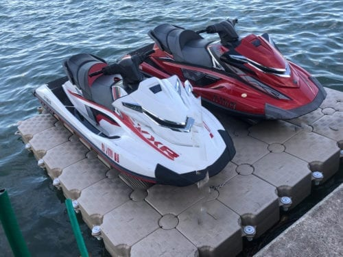 2 jet skis drive on floating dock