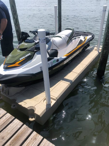 SeaDoo jet ski on a Candock JetROLL floating dock secured with 4 posts